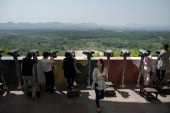 Tourists look out towards North Korea at the Dora Observatory near the truce village of Panmunjom in the Demilitarized Zone between North and South...