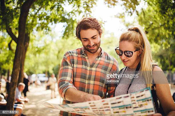 Tourists Looking at a Map in Barcelona