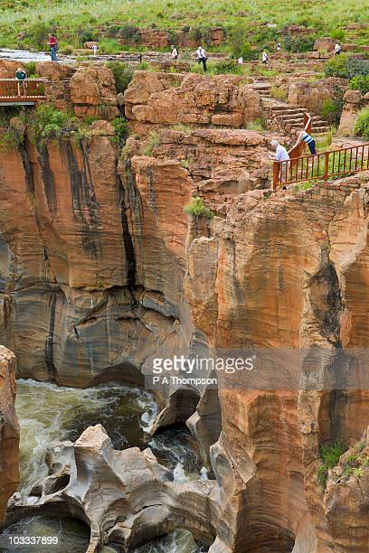Tourists looking at Bourkes Luck Potholes