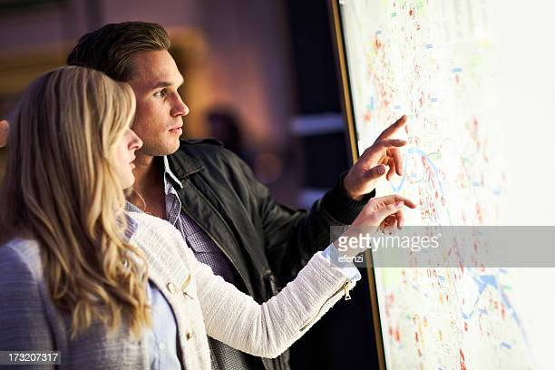 Tourists Looking At City Map