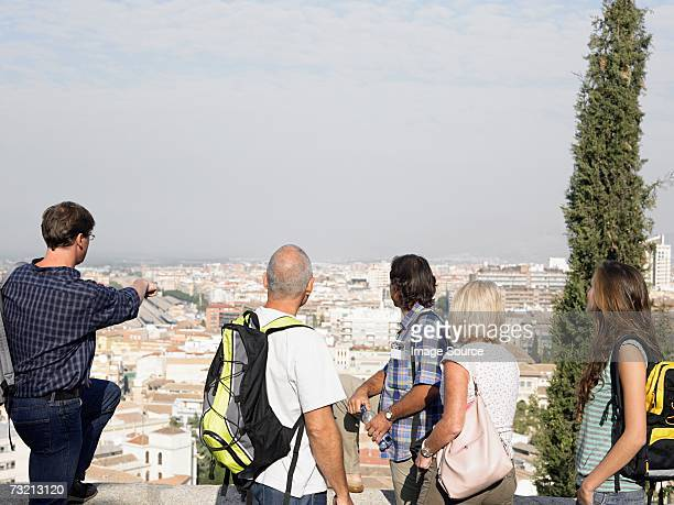 Tourists looking at view of city