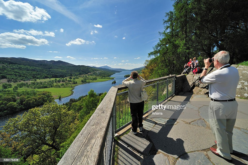 Tourists looking over Loch Tummel from Queen´_s View near Pitlochry in Perth and Kinross Scotland UK