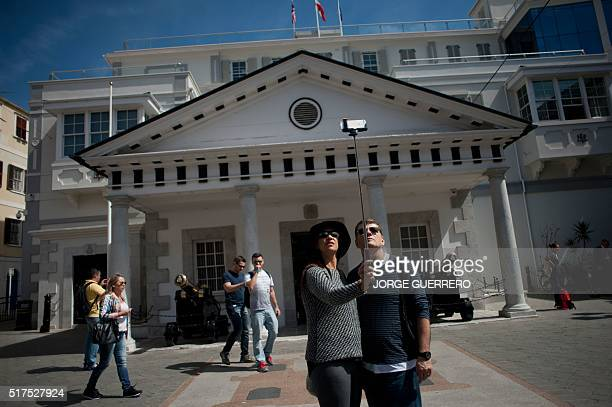 Tourists make a selfie in front of the House of Government of Gibraltar on March 17 2016 A British vote to leave the European Union would be a...
