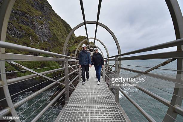 Tourists make their way along The Gobbins coastal path on August 19 2015 in Antrim Northern Ireland The Islandmagee cliff path walk has reopened...