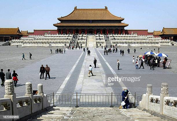 Tourists make their way inside the normally crowded Forbidden City the famed landmark home of dynastic emperors in central Beijing 16 June 2003 In a...
