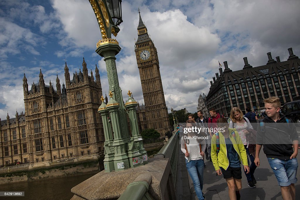 Tourists make their way over Westminster Bridge the day after the majority of the British public voted to leave the European Union on June 25, 2016 in London, England. The weakening of the pound against other currencies could mean good news for foreigners wishing to travel to the UK. The ramifications of the historic referendum yesterday that saw the United Kingdom vote to Leave the European Union are still being fully understood. The Labour leader, Jeremy Corbyn, who is under pressure from within his party to resign has blamed the 'Brexit' vote on 'powerlessness', 'austerity' and peoples fears over the issue of immigration.