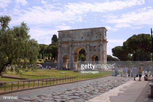 Tourists near a triumphal arch, Arch Of Constantine, Rome, Italy : Stock Photo