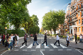 Tourists on the iconic Abbey Road zebra crossing