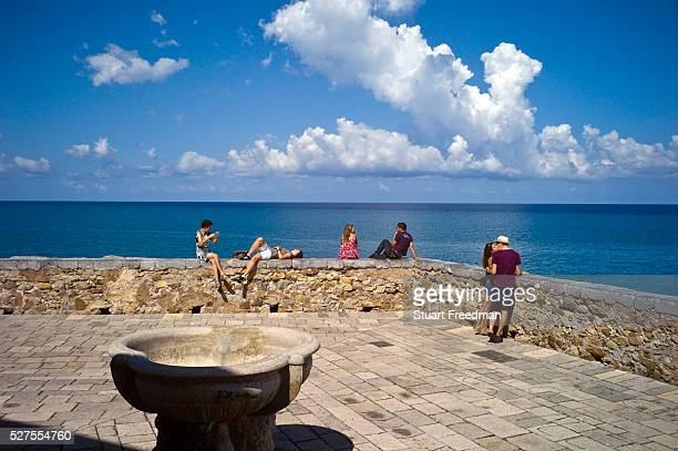 Tourists on the sea front at Cefalu Italy