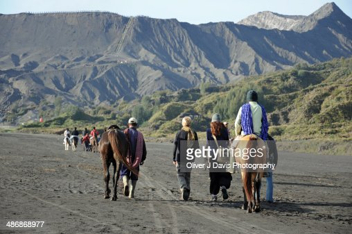 Tourists on the trail to crater of Bromo Volcano