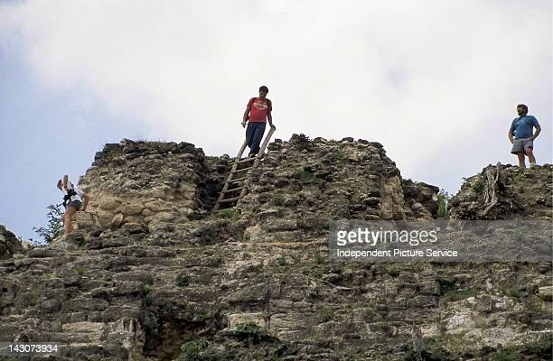 Tourists on top of the Mayan Temple of High Sacrifice or Structure N1043 at Lamanai Belize