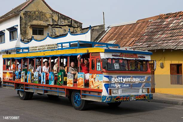Tourists on traditional Colombian Chiva bus