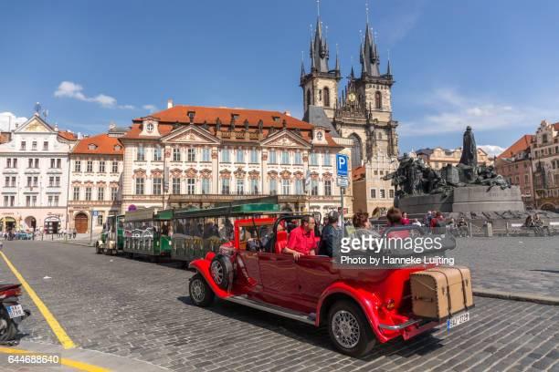 Tourists on vintage car tour through Prague