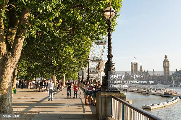 Tourists on Westminster Bridge, South Bank, London, UK