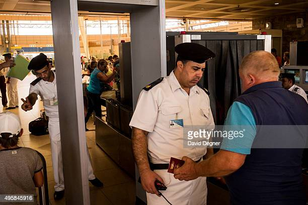Tourists pass through a main security barrier on the way to their flight on November 05 2015 in Sharm ElSheikh Egypt If the tourism industry in Egypt...