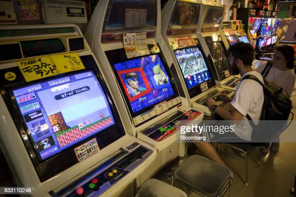 Tourists play at arcade video game machines inside the Super Potato video game store in the Akihabara district of Tokyo Japan on Tuesday Aug 8 2017...