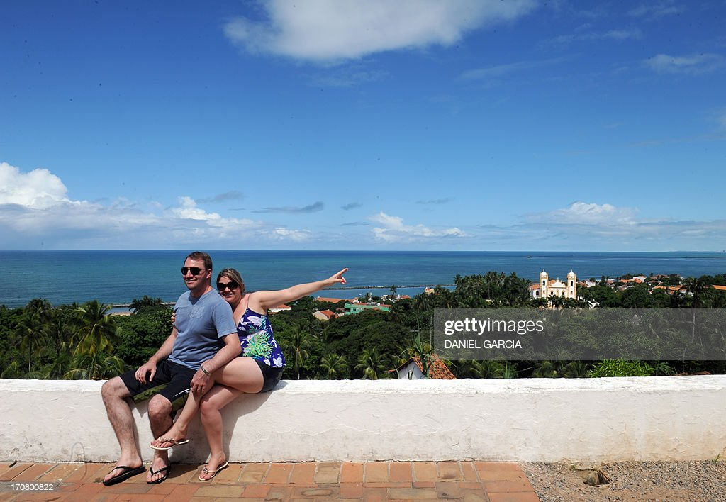 Tourists pose for a photograph in Olinda, state of Pernambuco on June 16, 2013. Olinda is located on the country's northeastern Atlantic Ocean coast, just north of Recife and it is the second oldest Brazilian city.