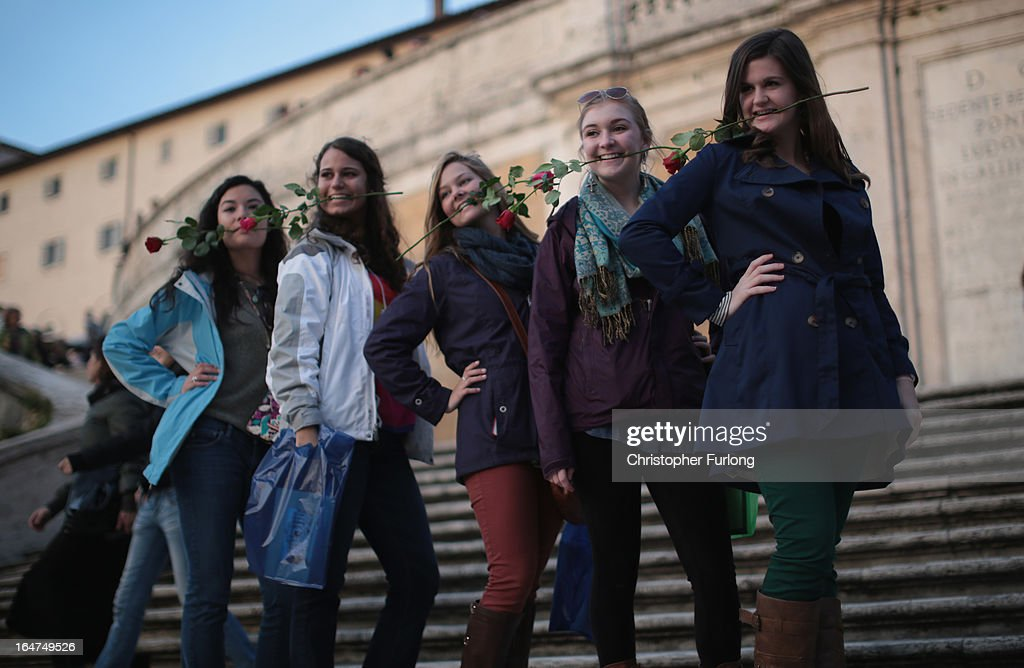 Tourists pose for a photograph on Rome's famous Spanish Steps on March 27, 2013 in Rome, Italy.