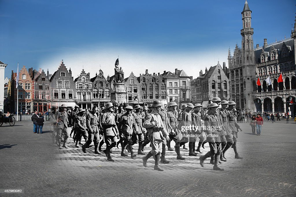 In this composite image a comparison has been made of Grote Markt. Commemorations of The First World War Centenary begin in 2014 and will last until 2018. British soldiers captured by the Troops of the Central Powers walking in the main square of the city escorted by the soldiers of the German army. Bruges, 1910s