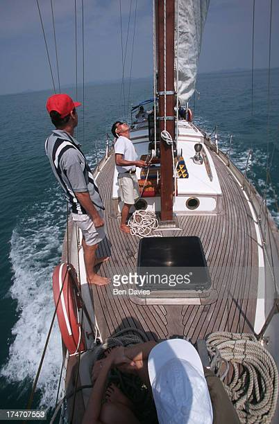 Tourists prepare to hoist the sail on a luxury yacht sailing around the islands of the Koh Chang National Marine Park in the Gulf of Thailand The...