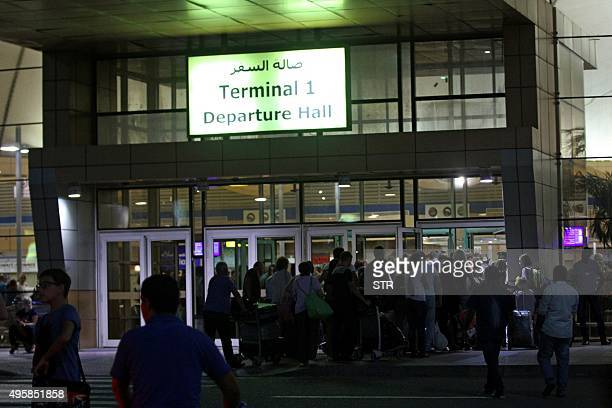 Tourists que at the departure gate outside the airport in Egypt's Red Sea resort of Sharm ElSheikh on November 5 2015 Britain and Ireland suspended...