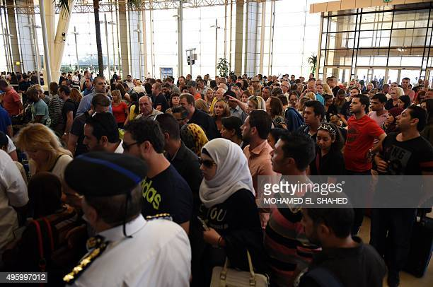 Tourists queue at the airport in Egypt's Red Sea resort of Sharm ElSheikh on November 6 2015 Britain moved to repatriate thousands of tourists from...
