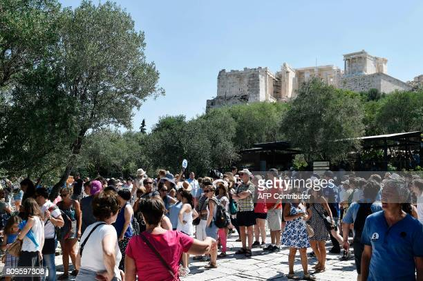Tourists queue for tickets at the entrance to the Acropolis archaeological site at the end of a guards's strike which kept the archaeological sites...