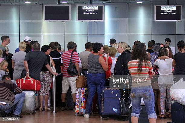 Tourists queue inside the airport in Egypt's Red Sea resort of Sharm ElSheikh on November 5 2015 Britain and Ireland suspended air links on November...