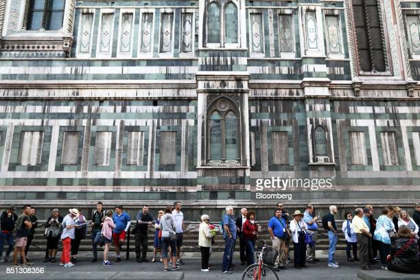 Tourists queue to enter the Cathedral di Santa Maria del Fiore in Florence Italy on Friday Sept 22 2017 UK Prime Minister Theresa May will use a...