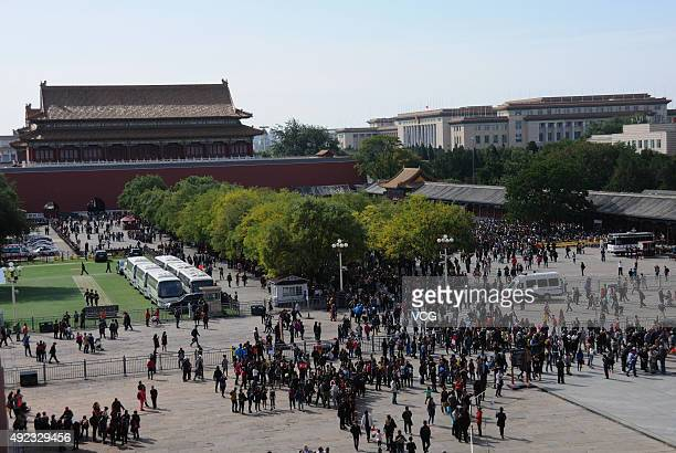 Tourists queue to visit a newly opened area inside the Palace Museum on October 11 2015 in Beijing China The Palace Museum opened areas including...