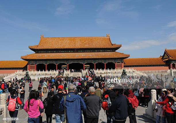 Tourists queue to visit the Palace Museum on October 11 2015 in Beijing China The Palace Museum opened areas including western section from the...