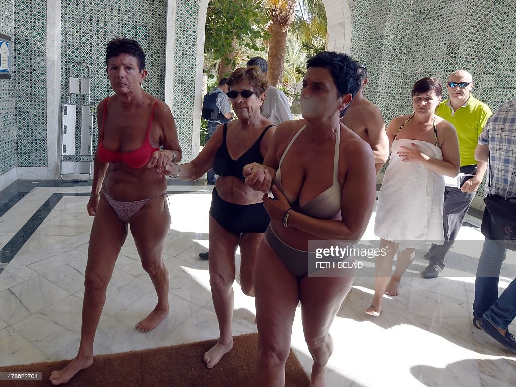 Tourists react in the Imperial hotel at the resort town of Sousse a popular tourist destination 140 kilometres south of the Tunisian capital on June...
