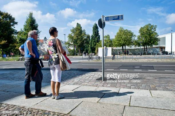 Tourists read a sign with directions road on September 14 2013 in Berlin Germany