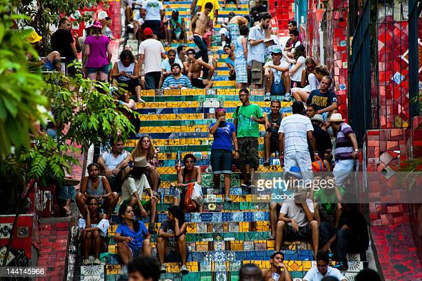 Tourists relax on Selaron's Stairs a colorful mosaic tile stairway on February 12 2012 in Rio de Janeiro Brazil World famous staircase mostly covered...