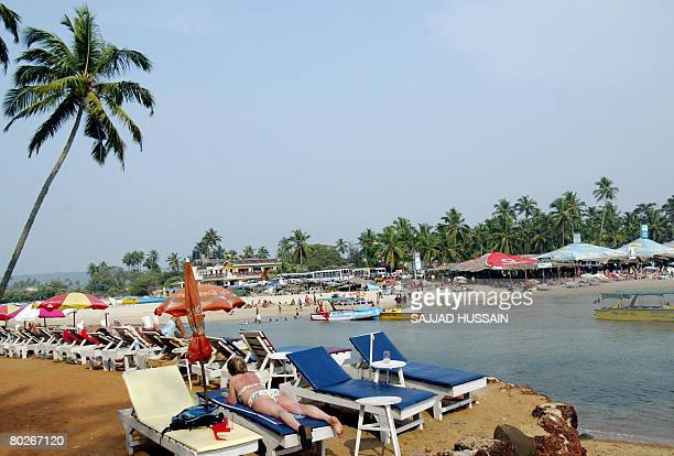 Tourists relax on sunbeds at Baga beach in Goa on March 16 2008 Continuing her attack on the Goa Police and politicians Fiona MacKeown mother of...