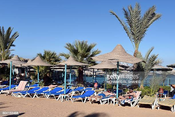 Tourists relax on the beach at the Bella Vista Hotel in Egypt's Red Sea resort of Hurghada on January 9 the day after the hotel came under attack by...