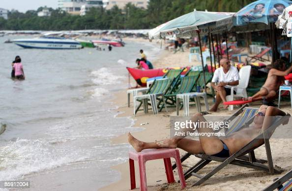 Tourists relax on the beach unaffected by the State of Emergency imposed by the Thai prime minister after protesters stormed the 14th ASEAN Summit on...