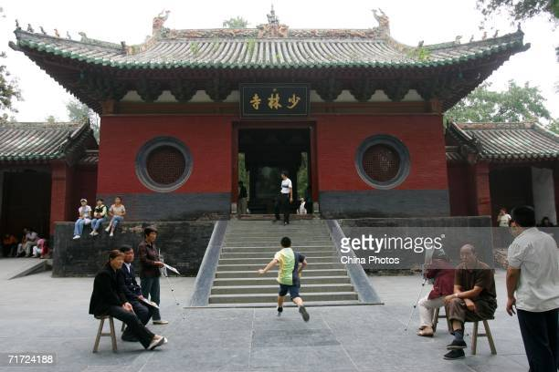 Tourists rest at the gate of Shaolin Temple on the Songshan Mountain on August 22 2006 in Dengfeng of Henan Province China Shaolin Temple built in AD...