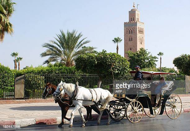 Tourists ride a horsedrawn carriage near the Koutoubia minaret and Jamaa elFna Square during a tour of Marrakesh on September 19 18 months after a...
