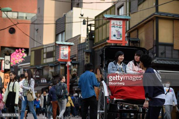 Tourists ride a rickshaw in the Asakusa district of Tokyo Japan on Monday March 20 2017 Japan's land prices will be released Tuesday evening The...