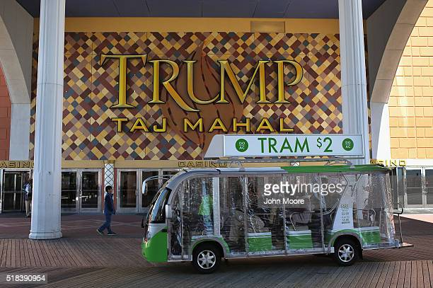 Tourists ride along the boardwalk at the Trump Taj Mahal casino hotel on March 30 2016 in Atlantic City New Jersey The Atlantic City municipality is...