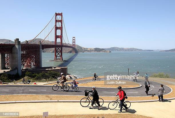 Tourists ride bicycles on a newly constructed bike path near the Golden Gate Bridge on May 24 2012 in San Francisco California The Golden Gate Bridge...