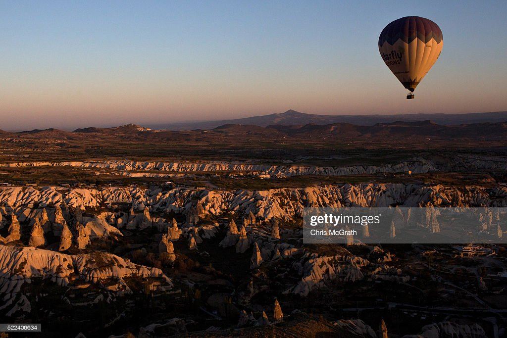 Tourists ride hot air balloon near the town of Goreme on April 17, 2016 in Nevsehir, Turkey. Cappadocia, a historical region in Central Anatolia dating back to 3000 B.C is one of the most famous tourist sites in Turkey. Listed as a World Heritage Site in 1985, and known for its unique volcanic landscape, fairy chimneys, large network of underground dwellings and some of the best hot air ballooning in the world, Cappadocia is preparing for peak tourist season to begin in the first week of May. Despite Turkey's tourism downturn, due to the recent terrorist attacks, internal instability and tension with Russia, local vendors expect tourist numbers to be stable mainly due to the unique activities on offer and unlike other tourist areas in Turkey such as Antalya, which is popular with Russian tourists, Cappadocia caters to the huge Asian tourist market.