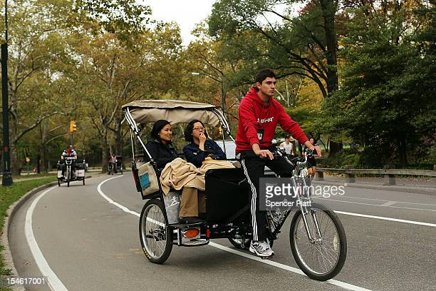 Tourists ride in a New York City pedicab through Central Park on October 23 2012 in New York City After a Texas family was charged $442 for a recent...