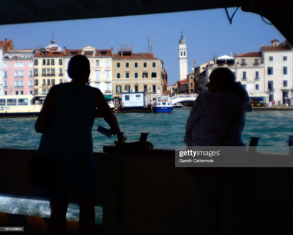 Tourists ride on a boat to St Mark's Square in Venice during the 69th Venice Film Festival on September 7, 2012 in Venice, Italy.