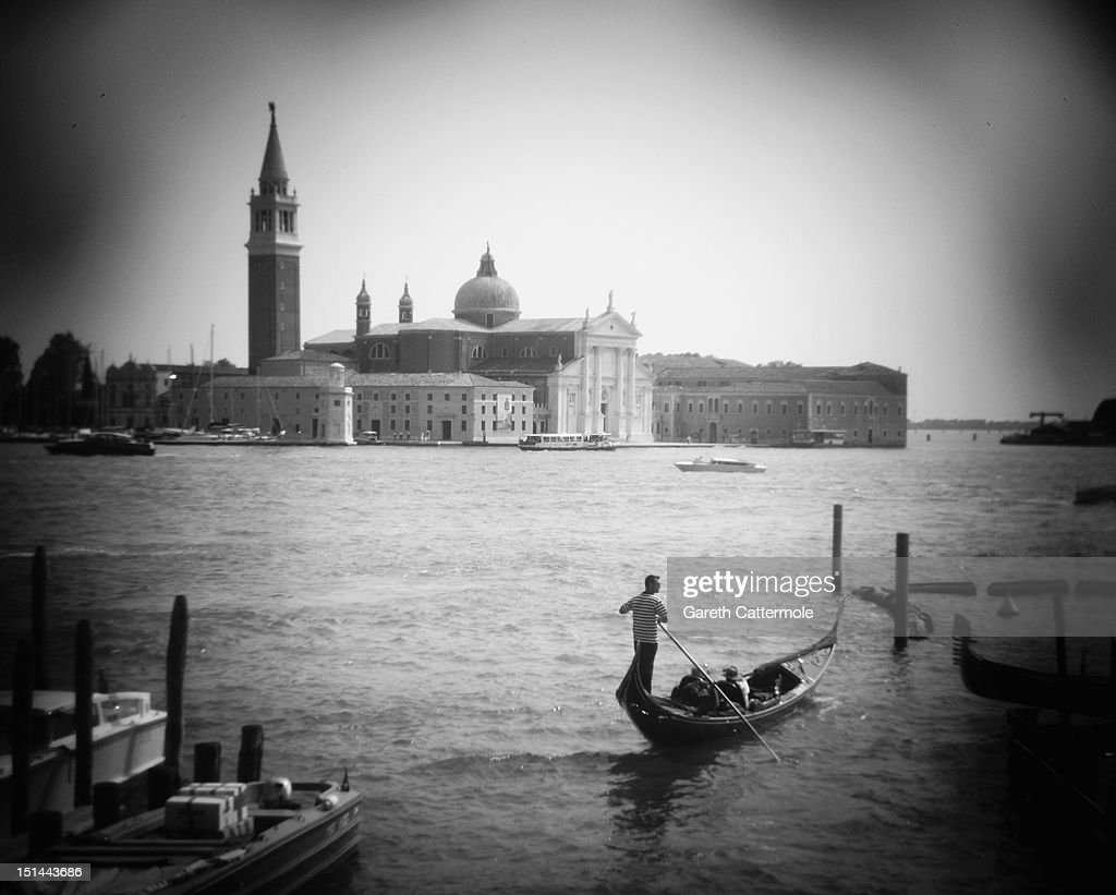 Tourists ride on a gondola during the 69th Venice Film Festival on September 7, 2012 in Venice, Italy.