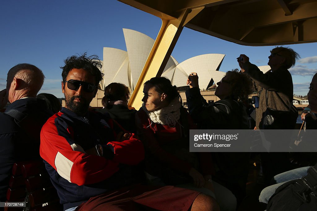 Tourists ride on a Sydney ferry past the Sydney Opera House on June 13, 2013 in Sydney, Australia. The New South Wales government is expected to commit AUD $14 million in it's 2014-15 budget to a ten year plan that will see the Sydney Opera House refurbished and it's facilities upgraded. The world-heritage listed landmark will celebrate it's 40th anniversary this October.