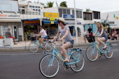 Tourists ride on rented bicycles in Puerto del Carmen on April 13 2014 in Lanzarote Spain Lanzarote where British Prime Minister David Cameron and...