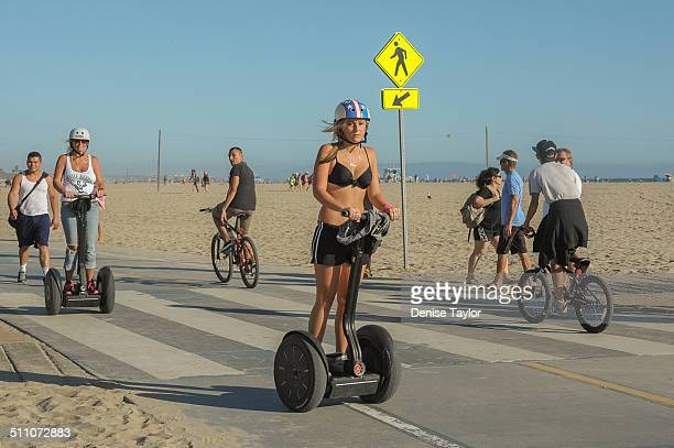 Tourists riding electric Scooters 'Segway' along the boardwalk at Santa Monica beach on August 17 2014