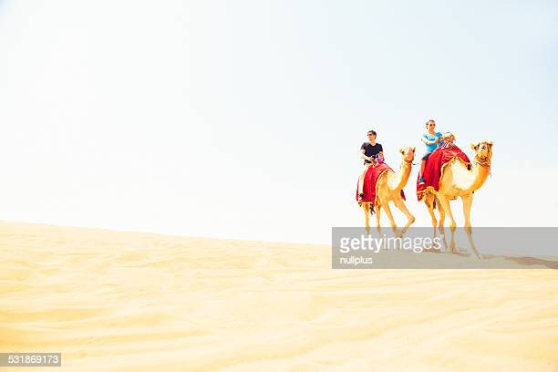 tourists riding through the desert